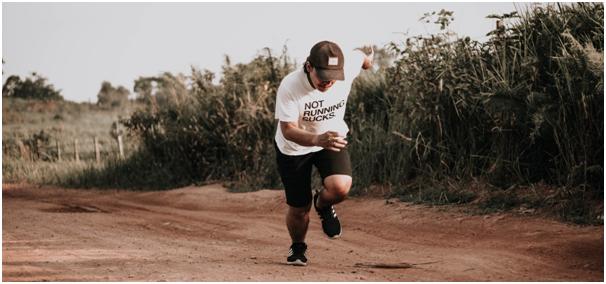 Larger man running wearing a Not Running Sucks shirt.